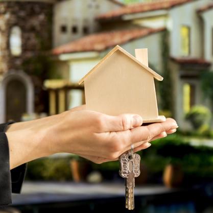 businesswoman-s-hand-holding-wooden-house-model-keys-against-blur-house_23-2148038697_1x1